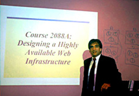 Photo of Norm Hebert introducing the course 'Designing a Highly Available Web Infrastructure'