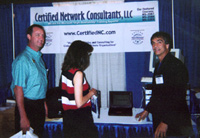 Photo of Norm Hebert displaying Cluster services to employees of NH-Denver